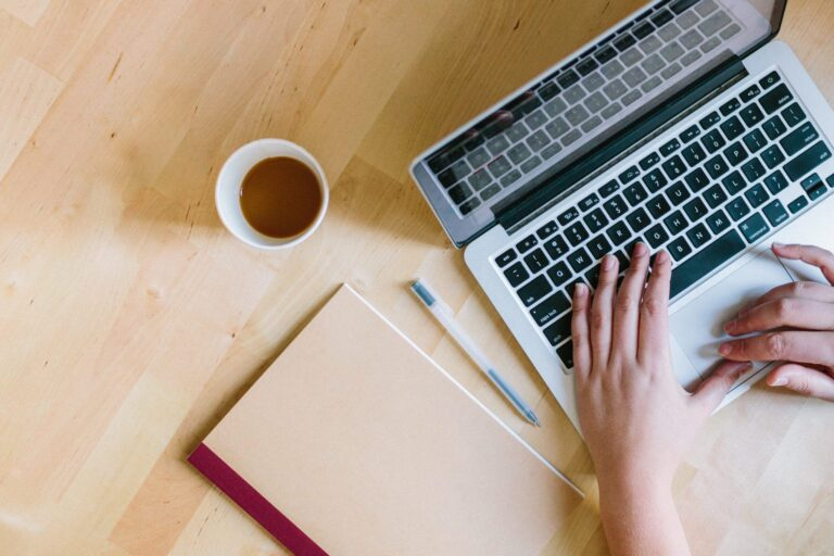 a writer working on an article while following the article writing tips from allied writers