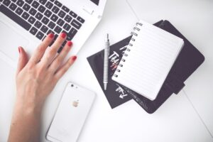 grant writing skills laptop iphone notebook pen