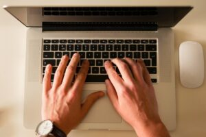 typing email writing mistakes in laptop