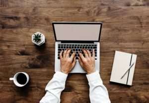 writing business blogs in a laptop