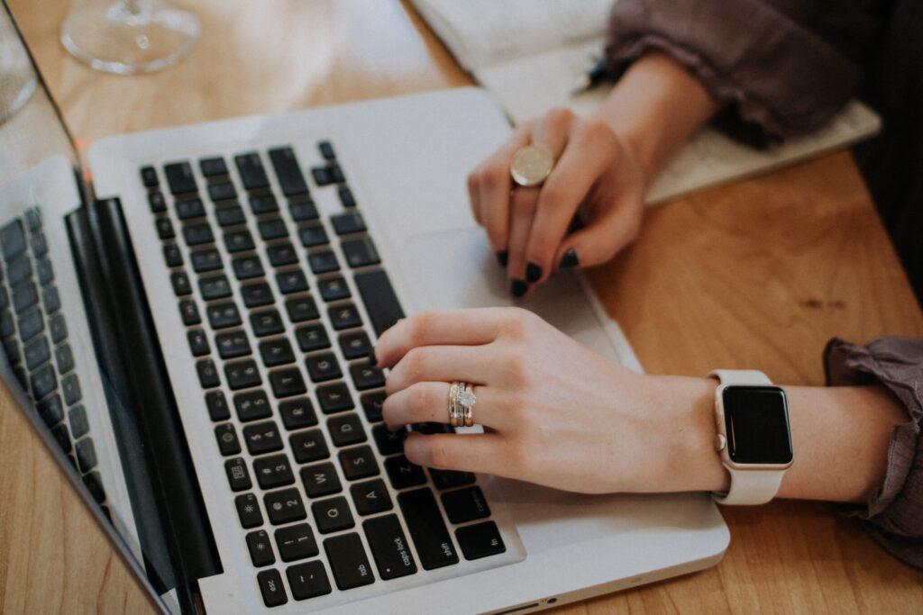 woman writing killer blog title