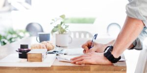 take note of these copywriting services hacks man writing on top of table