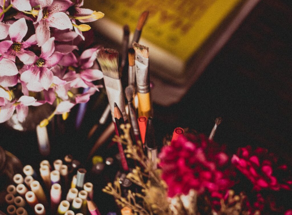 a bunch of flowers and paint brushes to replenish back your creative juices