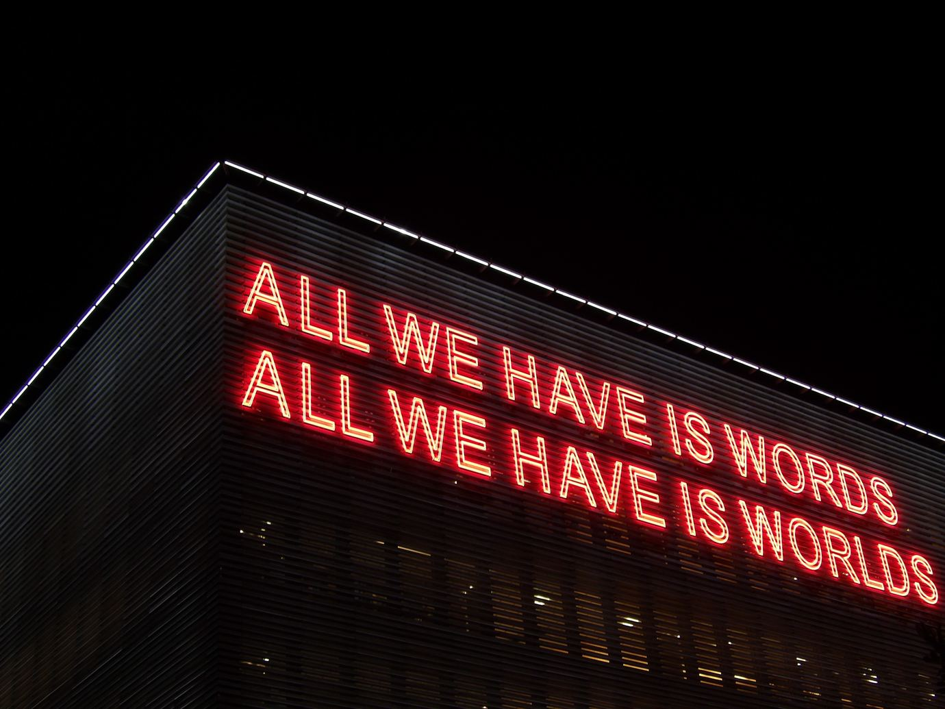 writing challenge LCD words on top of a building at night