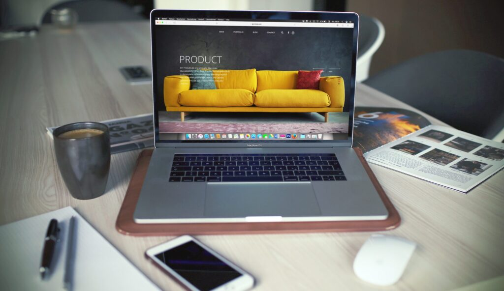 A laptop showing a yellow couch and the word product denoting product descriptions