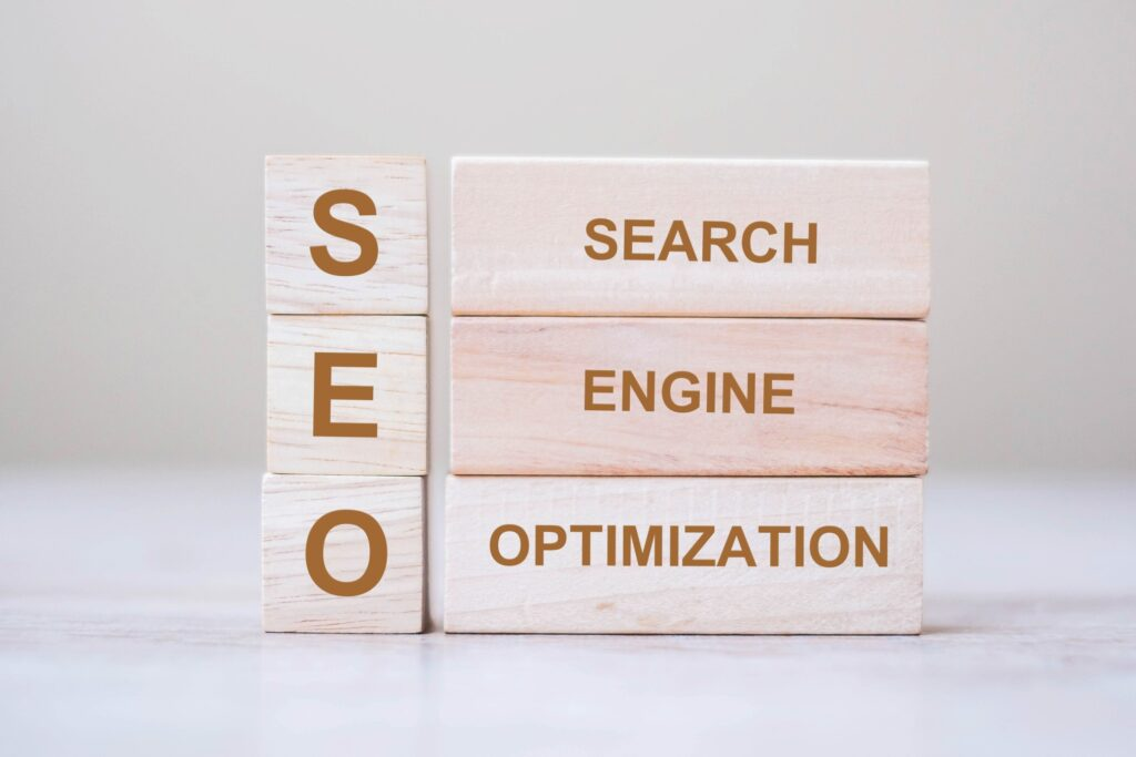 SEO (search engine optimization) text wooden cube blocks on table