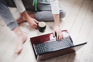 business owner blog writing on his laptop